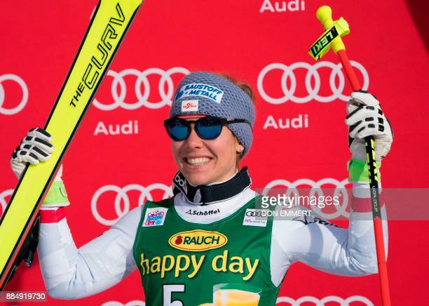 Nicole Schmidhofer of Austria celebrates her third place finish during the FIS Ski World Cup Women's Super G on December 3 2017 in Lake Louise Canada...