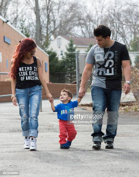 Nicole 'Snooki' Polizzi and her fiance Jionni LaValle pictured with their son Lorenzo LaValle on April 3 2014 in New Jersey are expecting their...