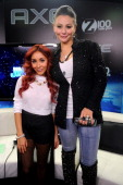 Nicole 'Snooki' Polizzi and Jennifer 'JWoww' Farley pose backstage at Z100's Jingle Ball 2013 presented by Aeropostale at Madison Square Garden on...