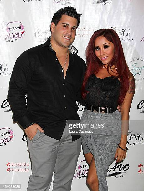 Nicole 'Snooki' Polizzi and Jionni LaValle attend the birthday party for Nicole 'Snooki' Polizzi at Cavo on December 6 2013 in the Queens borough of...