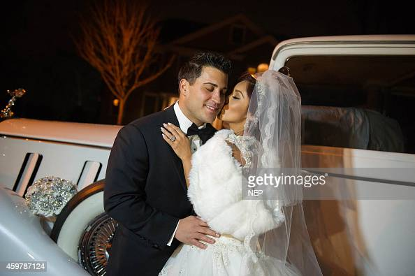Nicole 'Snooki' Polizzi and Jionni LaValle pose druign their wedding at St Rose Of Lima on November 29 2014 in East Hanover New Jersey Dress by Eve...