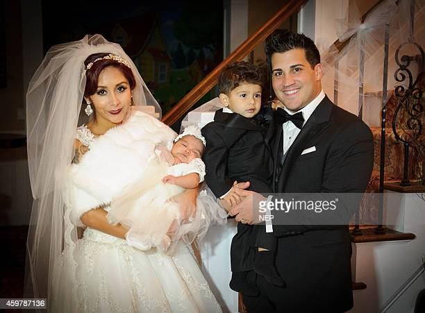Nicole 'Snooki' Polizzi and Jionni LaValle pose with their children Lorenzo LaValle and Giovanna LaValle druing the wedding of Nicole 'Snooki'Polissi...