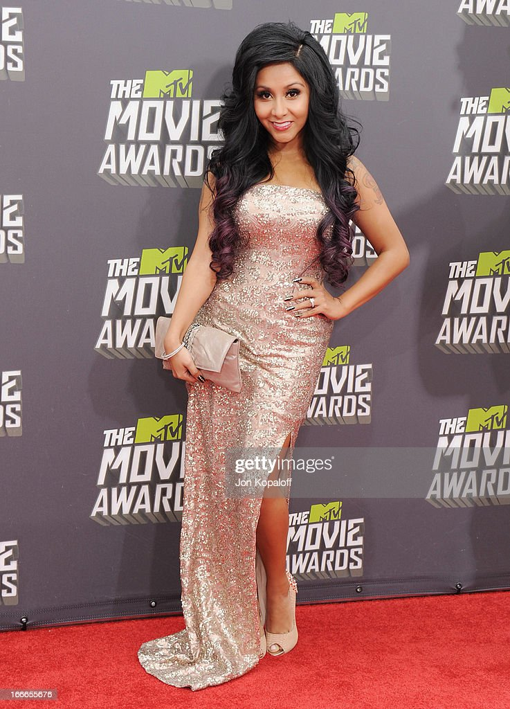 Nicole 'Snooki' Polizzi arrives at the 2013 MTV Movie Awards at Sony Pictures Studios on April 14, 2013 in Culver City, California.