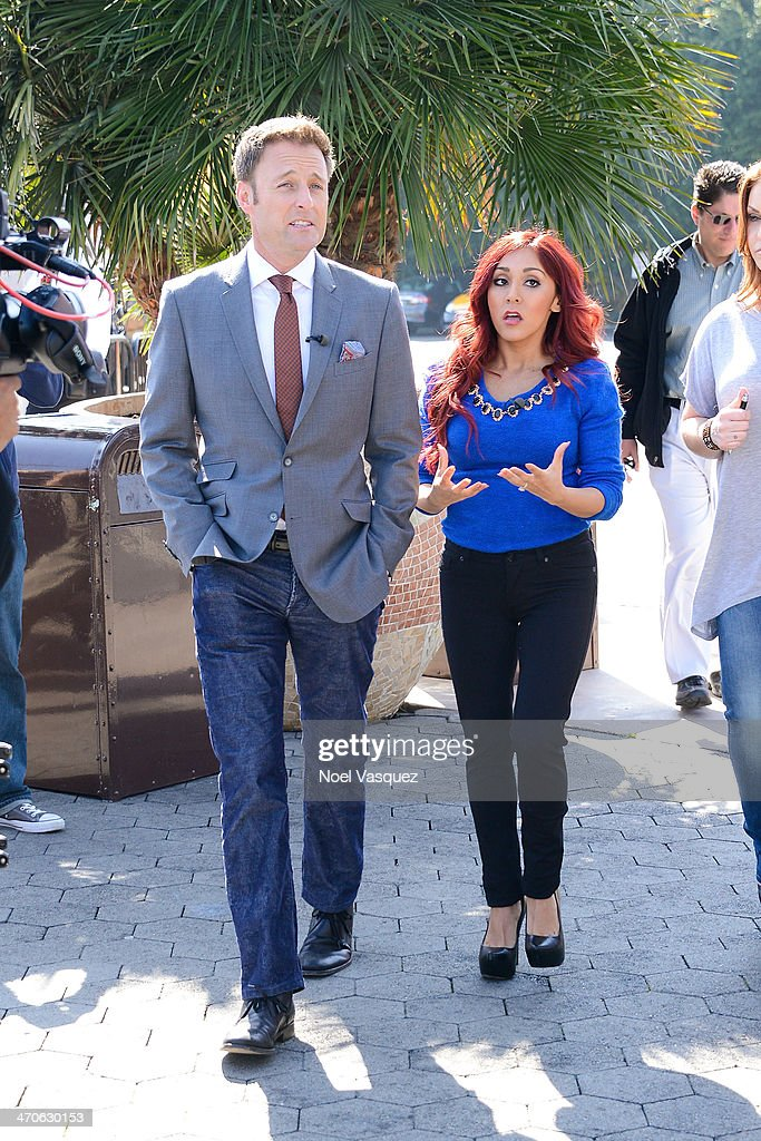 Nicole 'Snooki' Polizzi (R) interviews <a gi-track='captionPersonalityLinkClicked' href=/galleries/search?phrase=Chris+Harrison&family=editorial&specificpeople=583468 ng-click='$event.stopPropagation()'>Chris Harrison</a> for her new tv show at 'Extra' at Universal Studios Hollywood on February 19, 2014 in Universal City, California.