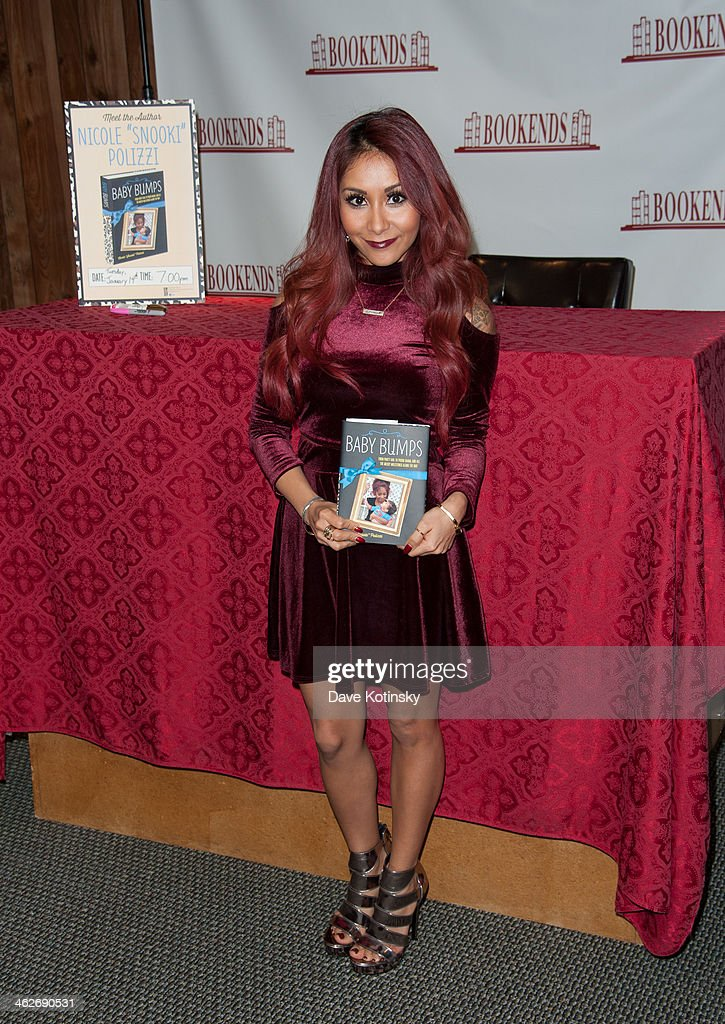 Nicole 'Snooki' Polizzi signs copies of her new book at Bookends Bookstore on January 14, 2014 in Ridgewood, New Jersey.
