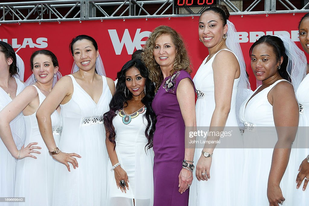 Nicole 'Snooki ' Polizzi, Tv President Kim Martin and contest participants attend the 'Bridezillas' Cake Eating Competition & WE TV's 10th Anniversary Celebration at Madison Square Garden on May 30, 2013 in New York City.