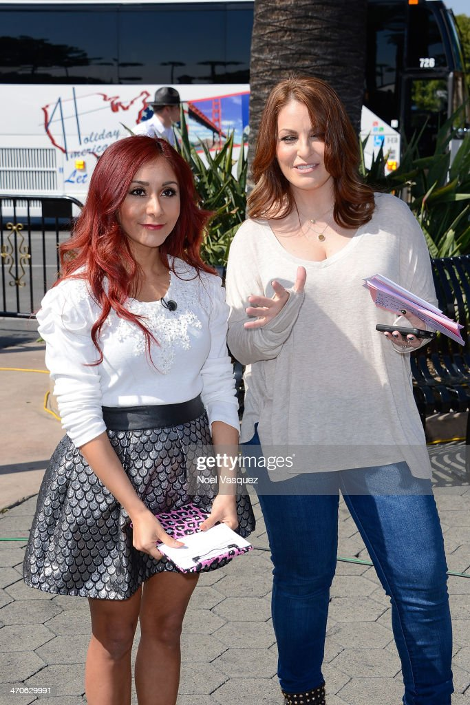 Nicole 'Snooki' Polizzi (L) visits 'Extra' at Universal Studios Hollywood on February 19, 2014 in Universal City, California.
