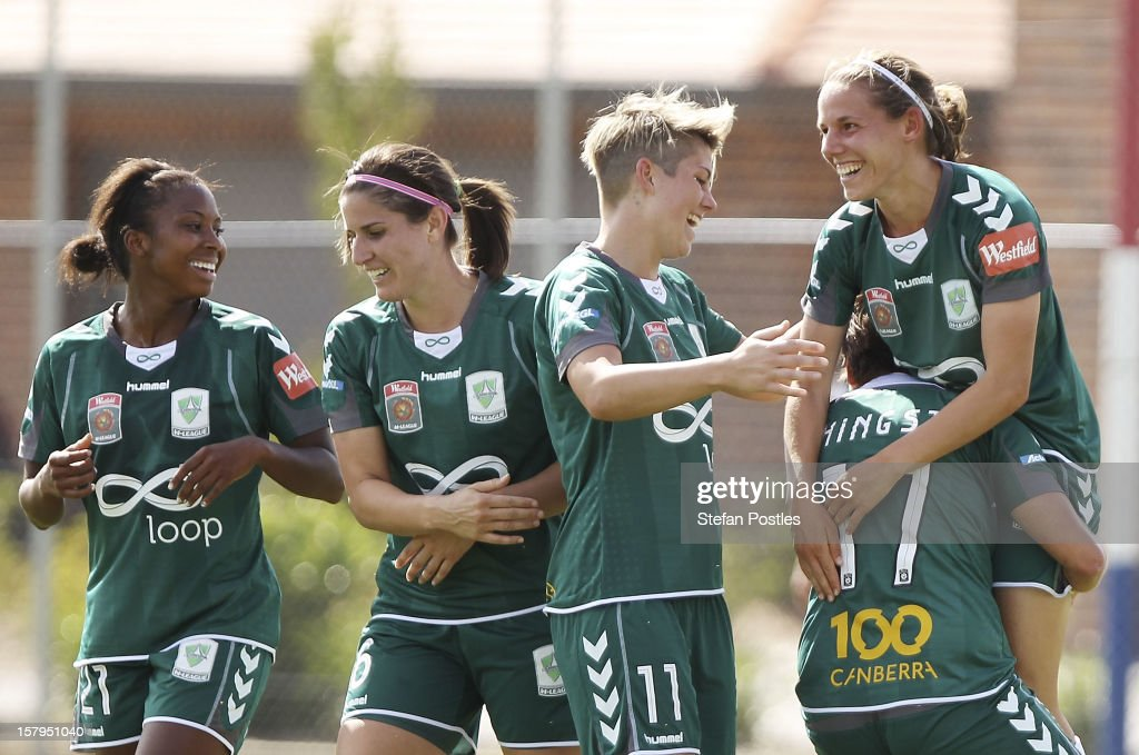 Nicole Sykes of Canberra United is congratulated by team mates after scoring a goal during the round eight W-League match between Canberra United and the Newcastle Jets at Deakin Football Stadium on December 8, 2012 in Canberra, Australia.