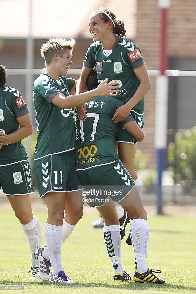 Nicole Sykes of Canberra United is lifted into the air after scoring a goal during the round eight W-League match between Canberra United and the Newcastle Jets at Deakin Football Stadium on December 8, 2012 in Canberra, Australia.