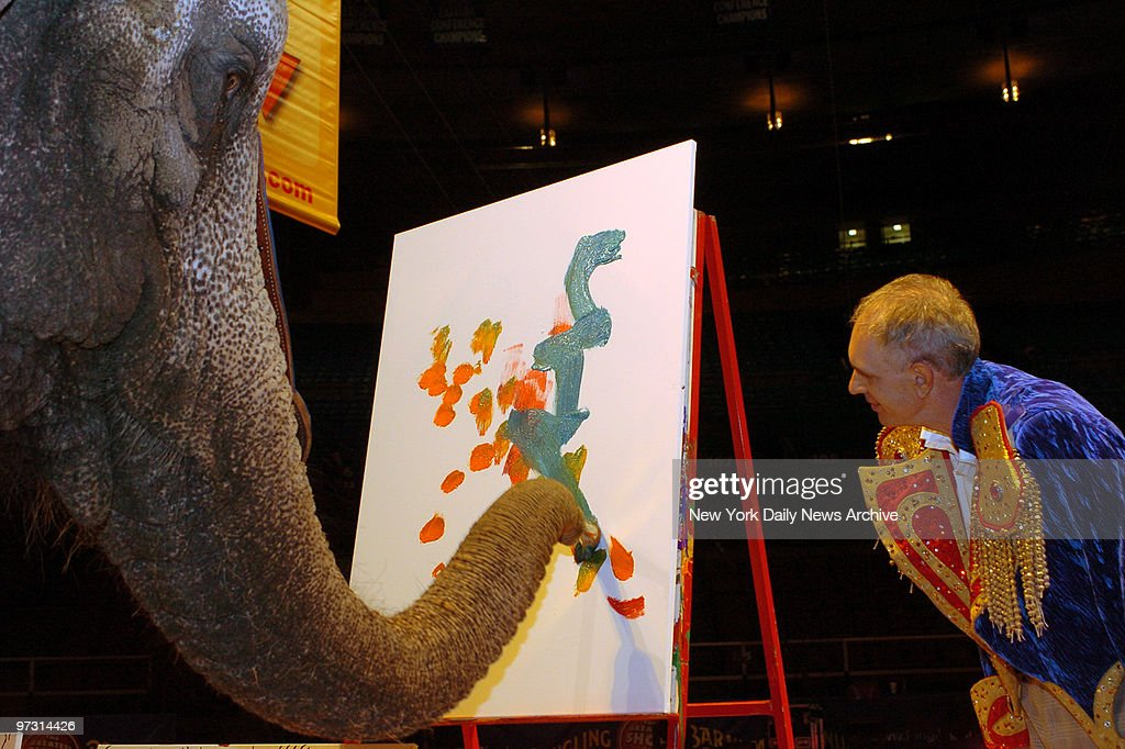Nicole the elephant, from Ringling Bros. and Barnum & Bailey Circus, shows off her artistic side as she paints a work for children of the local Ronald McDonald House as pop artist James Rizzi looks on. Rizzi and the 31-year-old painting pachyderm collaborated on pieces at Madison Square Garden where the circus is in town until the 17th.