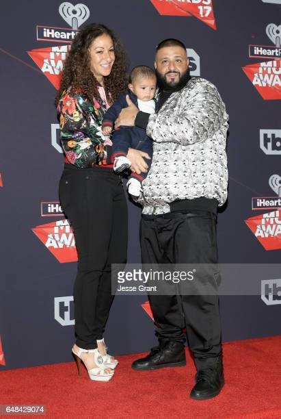 Nicole Tuck Asahd Tuck Khaled and DJ Khaled pose in the press room at the 2017 iHeartRadio Music Awards which broadcast live on Turner's TBS TNT and...