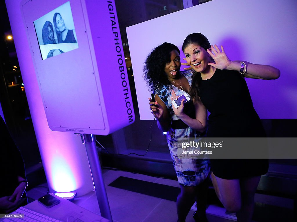 Nicole Vaughen and Christina Giordano at the photo booth during the IAC & Aereo IWNY HQ Closing Party on May 17, 2012 in New York City.