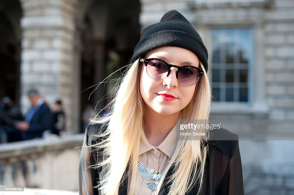 Nicole Vernon Design director at Olive clothing wearing Olive clothing shorts, jacket and shirt, hat ebay, Topshop Necklace and Jack and Wills Sunglasses on day 5 of London Fashion Week Spring/Summer 2013, on September 18, 2012 in London, England.