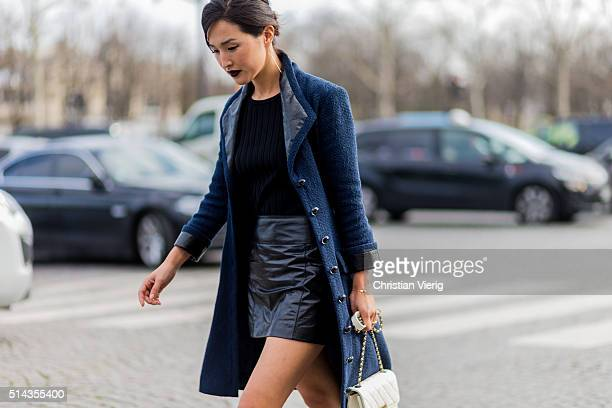 Nicole Warne wearing a navy coat black skirt and top and white Chanel bag outside Chanel during the Paris Fashion Week Womenswear Fall/Winter...