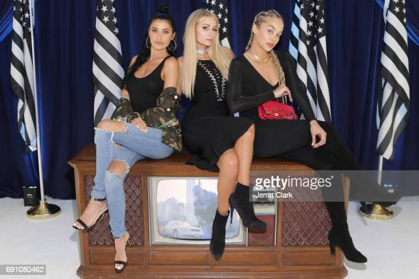Nicole Williams Paris Hilton and Jasmine Sanders attend Madeworn x Roc96 PopUp Event at on May 31 2017 in Los Angeles California