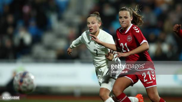 Nicole Woldmann of Germany and Emilie Pruesse of Denmark compete for the ball during the U16 Girls international friendly match betwwen Denmark and...