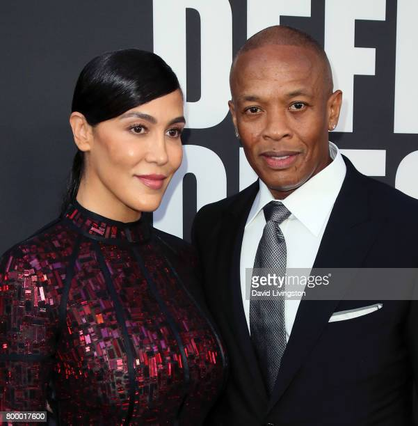 Nicole Young and husband record producer Dr Dre attend the premiere of HBO's 'The Defiant Ones' at the Paramount Theatre on June 22 2017 in Hollywood...