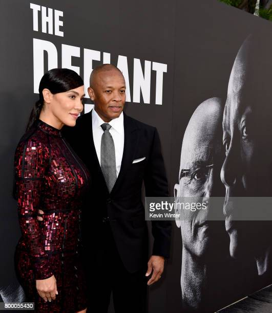 Nicole Young and producer Dr Dre arrive at the premiere screening of HBO's 'The Defiant Ones' at Paramount Studios on June 22 2017 in Los Angeles...
