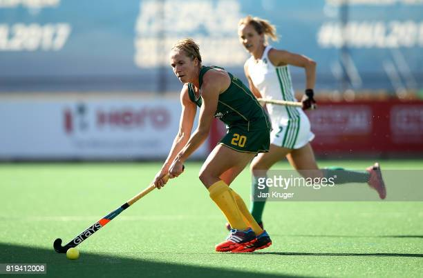 Nicolene Terblanche of South Africa controls the ball from Nicola Daly of Ireland during the 5th/ 8th place playoff match between South Africa and...