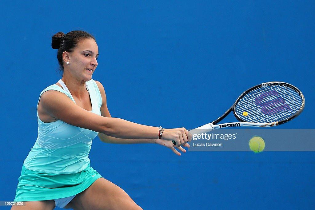 Nicoleta Dascalu of Romania plays a forehand in her first round match against Oleksandra Korashvili of the Ukraine during the 2013 Australian Open Junior Championships at Melbourne Park on January 19, 2013 in Melbourne, Australia.