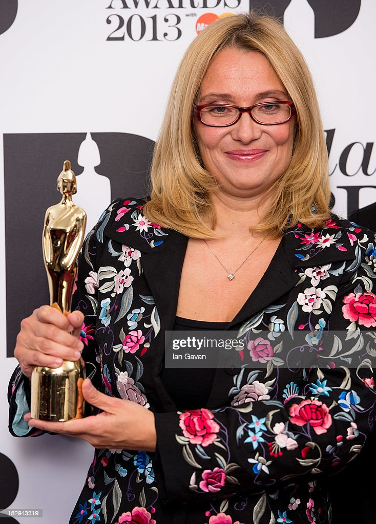 Nicoletta Mantovani accepts the Lifetime Achievement Award on behalf of Luciano Pavarotti in the winners room at the Classic BRIT Awards 2013 at Royal Albert Hall on October 2, 2013 in London, England.