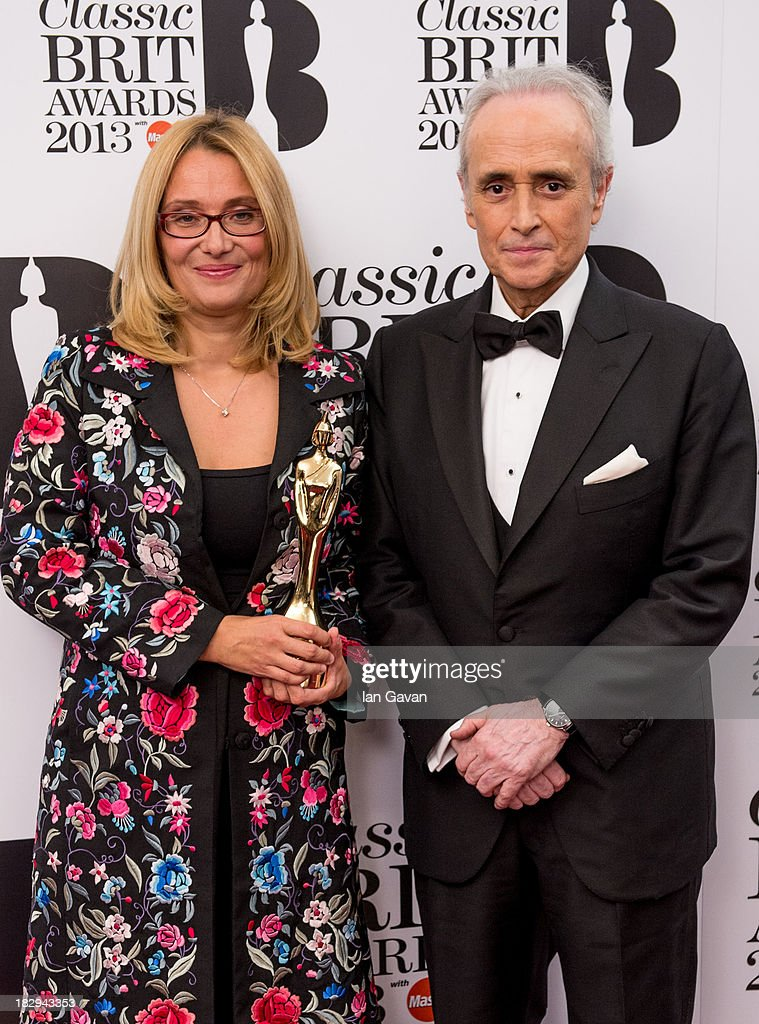 Nicoletta Mantovani accepts the Lifetime Achievement Award on behalf of Luciano Pavarotti with Jose Carreras in the winners room at the Classic BRIT Awards 2013 at Royal Albert Hall on October 2, 2013 in London, England.