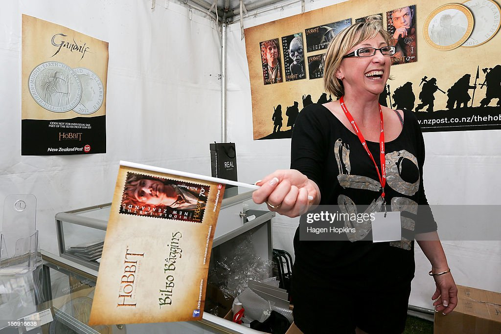 Nicolette Allen holds a promotional flag in the NZ Post stall during the Hobbit Artisan Market ahead of the 'The Hobbit: An Unexpected Journey' world premiere at Waitangi Park on November 25, 2012 in Wellington, New Zealand.