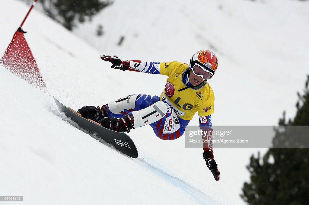 <a gi-track='captionPersonalityLinkClicked' href=/galleries/search?phrase=Nicolien+Sauerbreij&family=editorial&specificpeople=869490 ng-click='$event.stopPropagation()'>Nicolien Sauerbreij</a> of the Netherlands takes the globe for the overall World Cup during the LG Snowboard FIS World Cup Women's Parallel Giant Slalom on March 21, 2010 in La Molina, Spain.