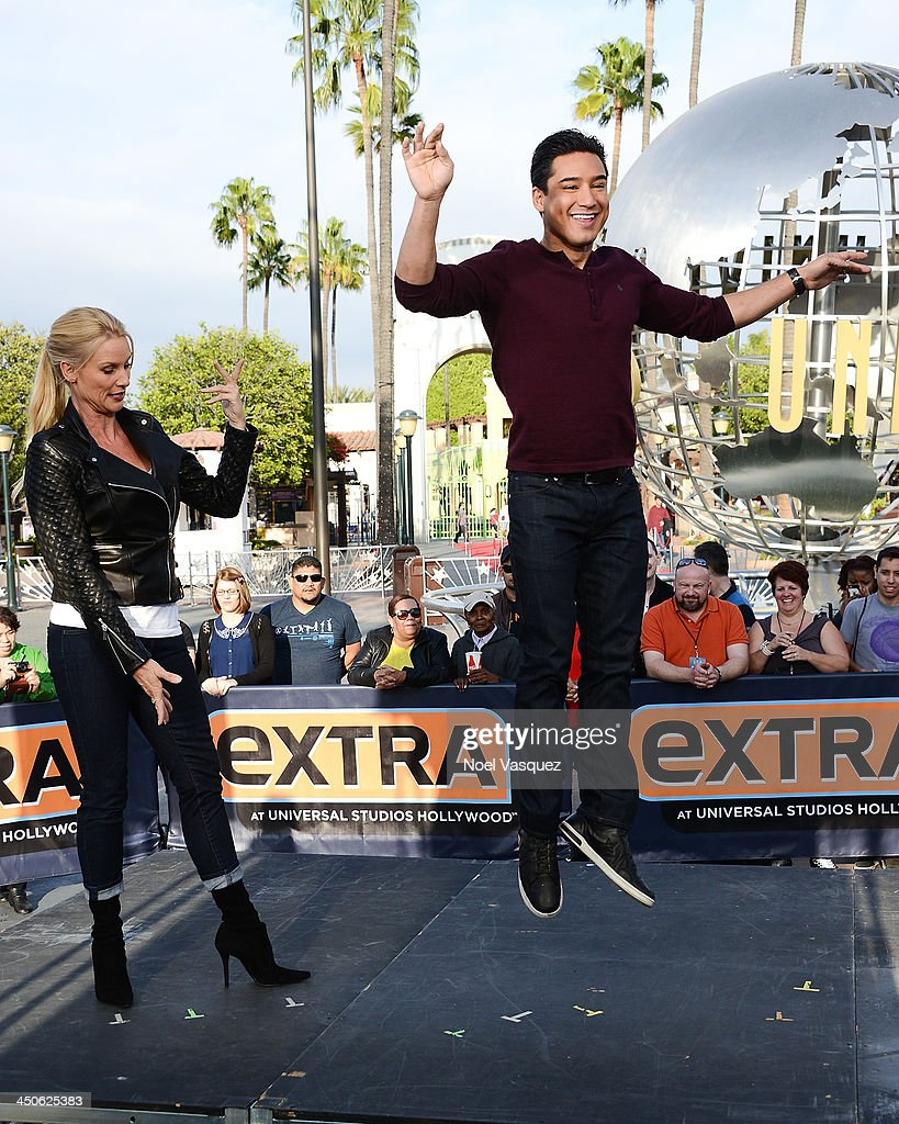 Nicollette Sheridan and Mario Lopez practice ballet at 'Extra' at Universal Studios Hollywood on November 19 2013 in Los Angeles California