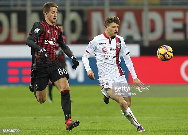 Nicolo Barella of Cagliari Calcio competes for the ball with Mario Pasalic of AC Milan during the Serie A match between AC Milan and Cagliari Calcio...