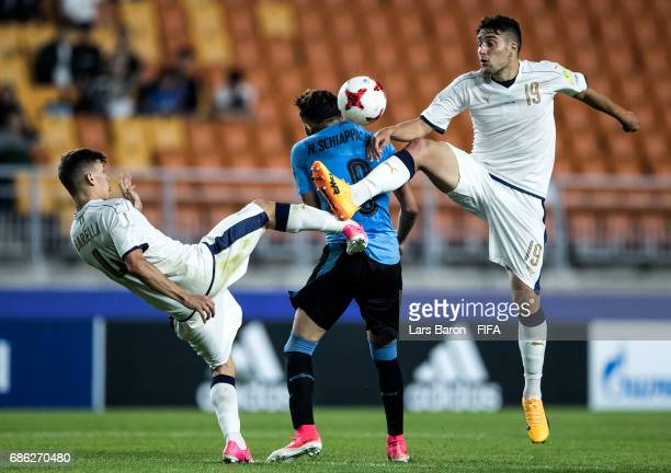 Nicolo Barella of Italy and Riccardo Marchizza of Italy challenge Nicolas Schiappacasse of Uruguay for the ball during the FIFA U20 World Cup Korea...