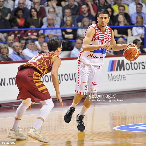 Nicolo Basile of Consultinvest competes with Michele Ruzzier of Umana during the LegaBasket match between Reyer Umana Venezia vs Victoria Libertas...
