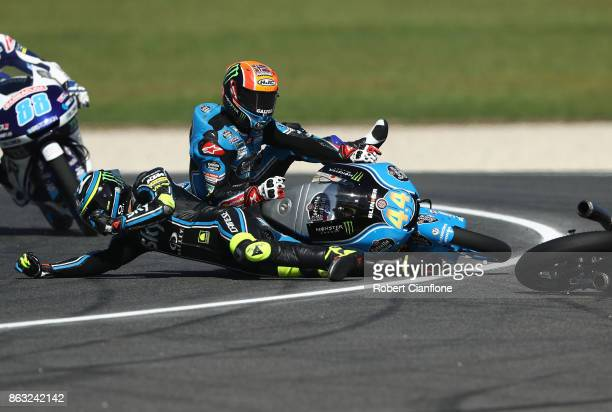 Nicolo Bulega of Italy and riding the Sky Racing Team VR46 KTM crashes into Aron Canet of Spain and rider of the Estrella Galicia 00 Honda during...