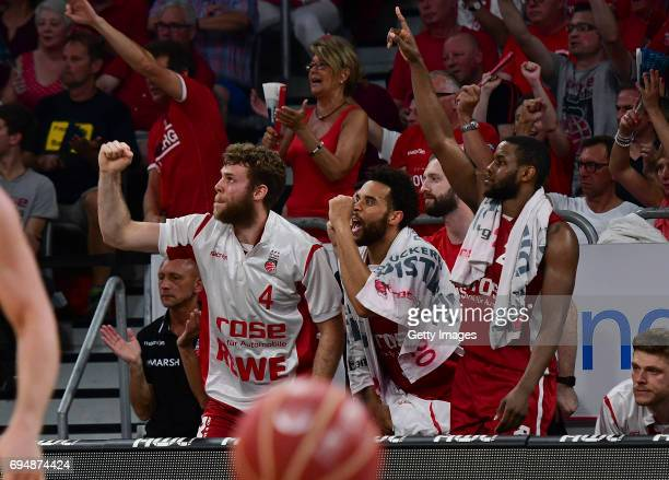 Nicolo Melli Elias Harris and Darius Miller of Bamberg celebrate a succefull threepointshot during game 3 of the 2017 BBL Finals at Brose Arena on...