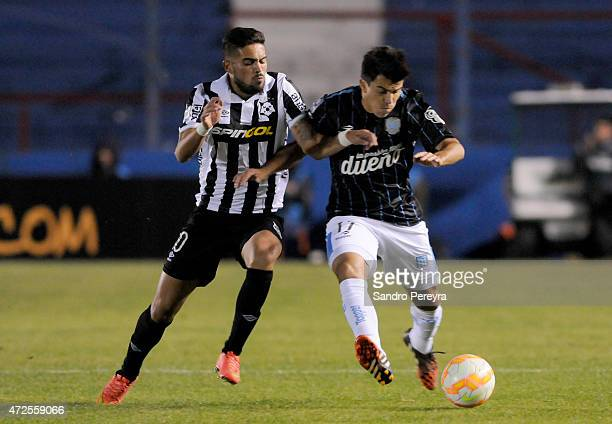 Nicolás Albarracín of Montevideo Wanderers and Marcos Acuña of Racing Club fight for the ball during a first leg match between Montevideo Wanderers...