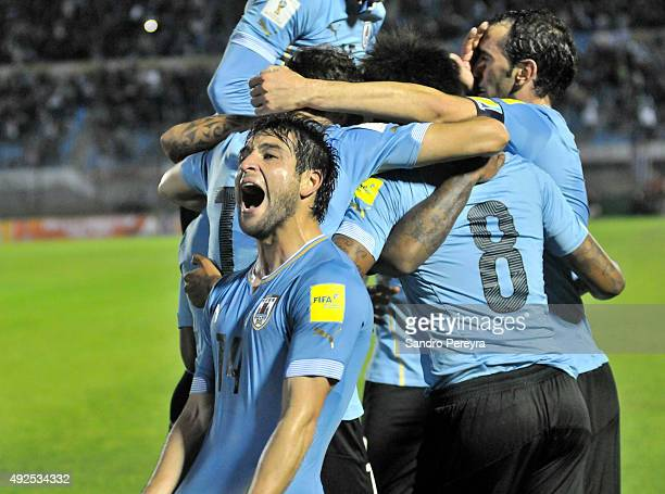 Nicolás Lodeiro of Uruguay celebrates with teammates after Abel Hernandez scored the third goal during a match between Uruguay and Colombia as part...