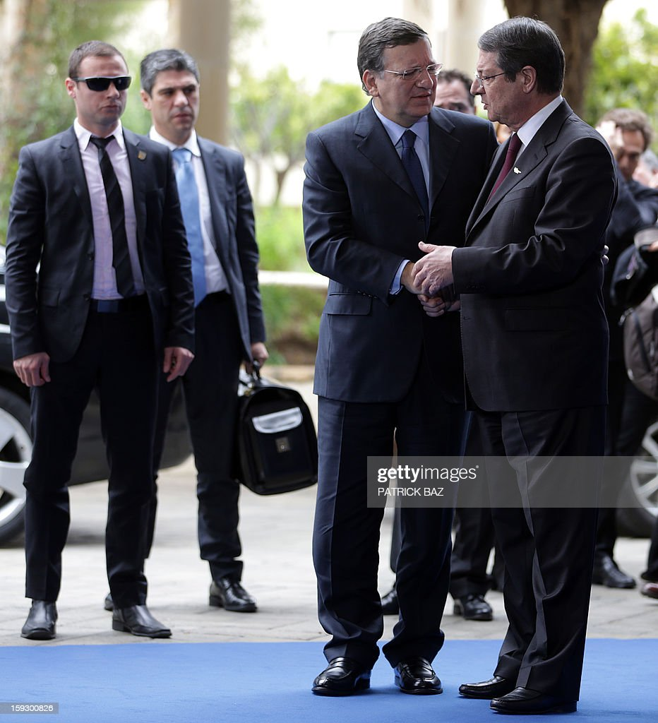 Nicos Anastasiades (R), President of the Democratic Rally of Cyprus greets the President of the European Commission Jose Manuel Barroso (C) upon the latter's arrival to the extraordinary EPP summit in Limassol on January 11, 2013, attended by EU Heads of State, party leaders, and the Presidency of the European People's Party (EPP).