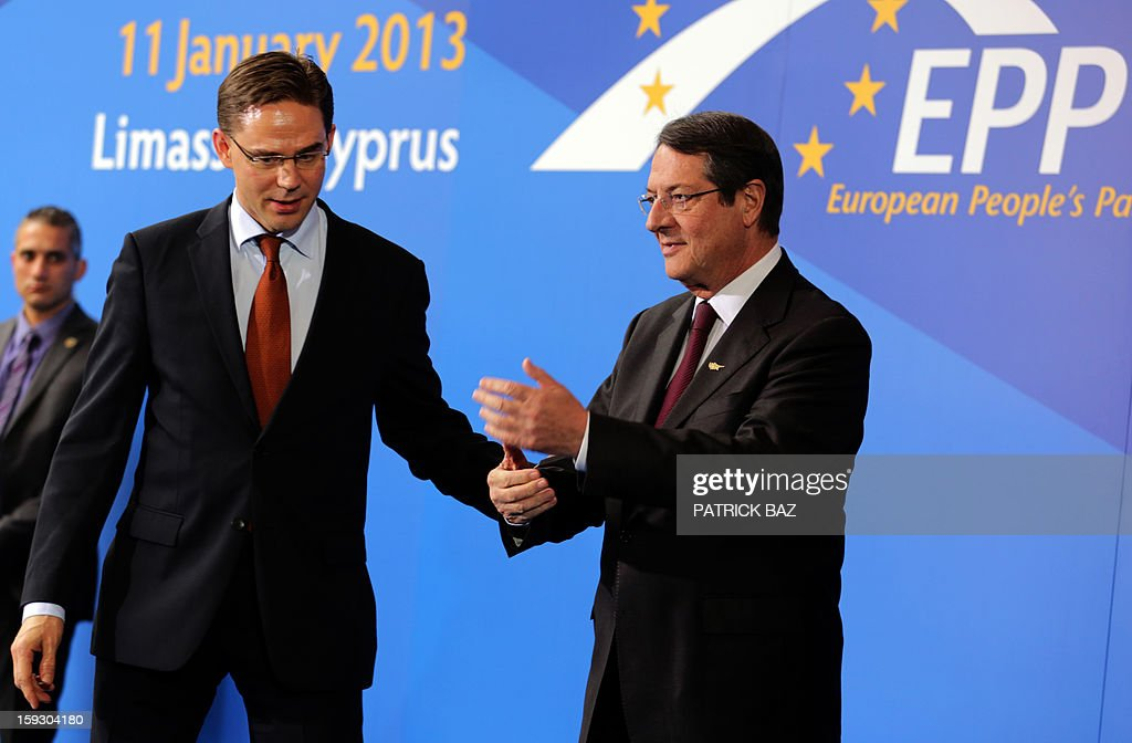 Nicos Anastasiades (R) President of the Democratic Rally of Cyprus (DISY) talks with Finland's Prime Minister Jyrki Katainen prior to the start of the extraordinary European People's Party (EPP) summit in Limassol on January 11, 2013, attended by EU heads of state, party leaders, and the presidency of the EPP.