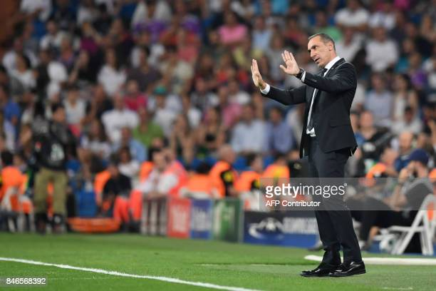Nicosia's coach from Greece Giorgos Donis gestures during the UEFA Champions League football match Real Madrid CF vs APOEL FC at the Santiago...