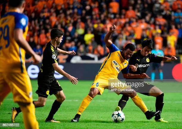 Nicosia's Dutch forward Lorenzo Ebicilio is marked by Dortmund's Japanese midfielder Shinji Kagawa and Dortmund's US midfielder Christian Pulisic...