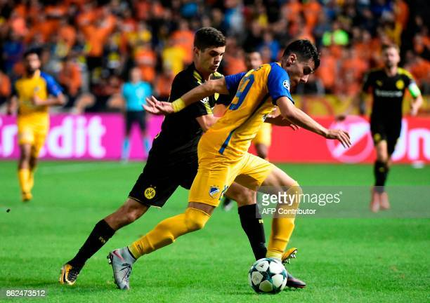 Nicosia's Greek defender Praxitelis Vouros is marked by Dortmund's US midfielder Christian Pulisic during the UEFA Champions League football match...