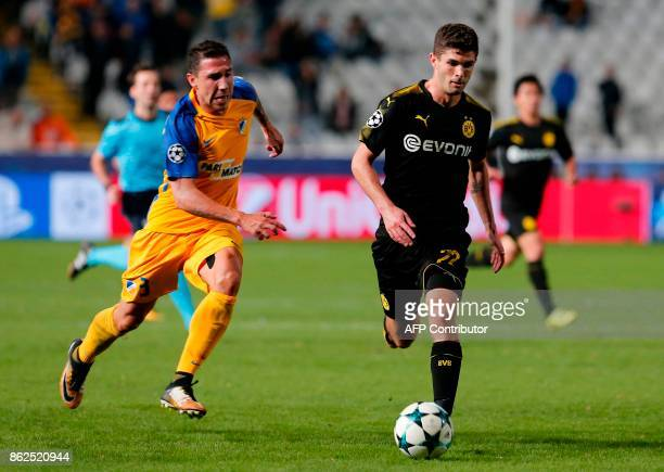 Nicosia's Spanish defender Roberto Lago chases Dortmund's US midfielder Christian Pulisic during the UEFA Champions League football match between...