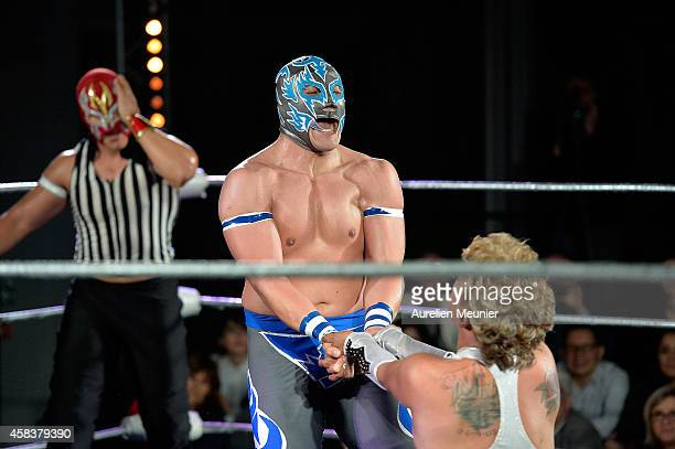 Niebla Roja Puma King and Cassandro El Exotico perform onstage during the EXOTICOS VS LUCHADORES Lucha Libre Show hosted by La Fondation Cartier in...