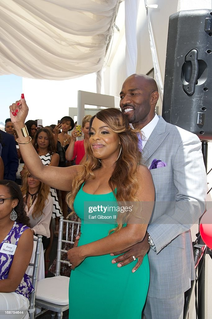 <a gi-track='captionPersonalityLinkClicked' href=/galleries/search?phrase=Niecy+Nash&family=editorial&specificpeople=228464 ng-click='$event.stopPropagation()'>Niecy Nash</a> and husband Jay Tucker enjoy a moment together as they celebrate the release of of new book 'It's Hard to Fight Naked' at Luxe Rodeo Drive Hotel on May 14, 2013 in Beverly Hills, California.