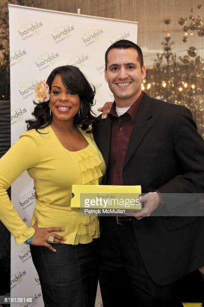 Niecy Nash and Tom Sesti attend Silver Spoon Presents Oscar Weekend Red Cross Event For Haiti Relief at Interior Illusions on March 3 2010 in West...