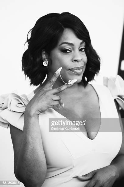 Niecy Sash attends the Turner Upfront 2017 arrivals on the red carpet at The Theater at Madison Square Garden on May 17 2017 in New York City...