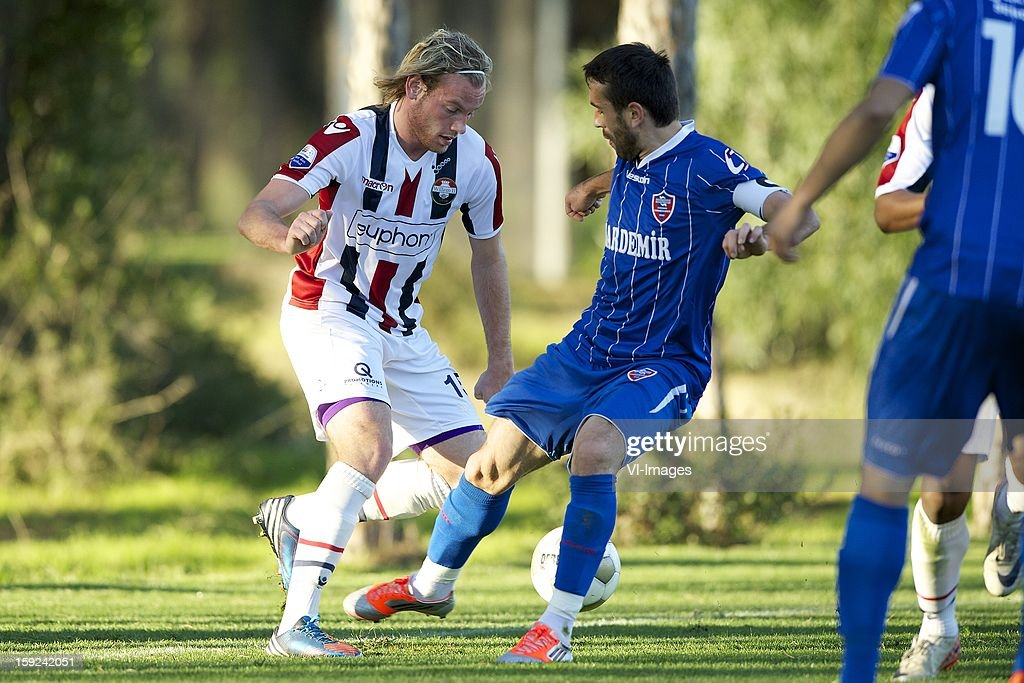 Niek Vossebelt of Willem II, Birol Hikmet of Karabukspor during the match between Willem II and Karabukspor on January 10, 2013 at Belek, Turkey.