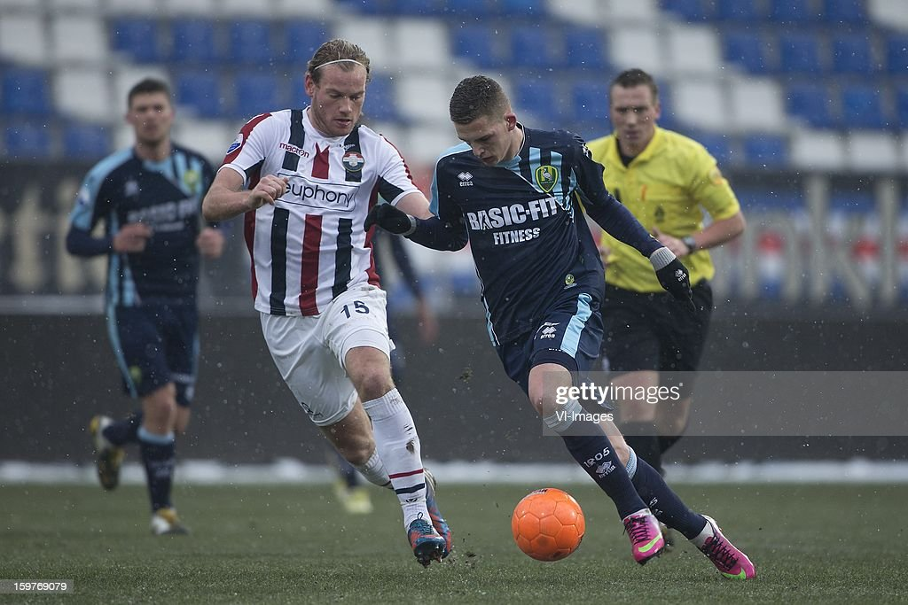 Niek Vossebelt of Willem II, Kevin Jansen of ADO Den Haag during the Dutch Eredivise match between Willem II and ADO Den Haag at the Koning Willem II Stadium on January 20, 2013 in Tilburg, The Netherlands.