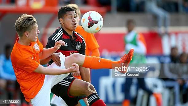 Niels Ens of Netherlands challenges Noah Awuku of Germany during the international friendly match between U15 Netherlands and U15 Germany at the DETO...