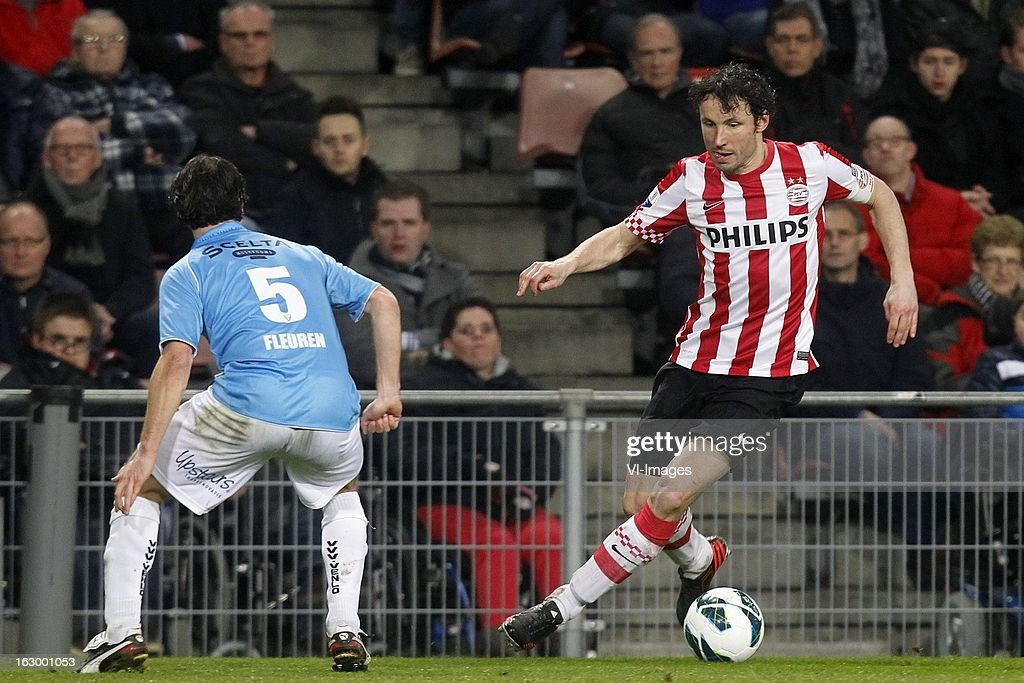 Niels Fleuren of VVV-Venlo (L), Mark van Bommel of PSV (R) during the Dutch Eredivisie match between PSV Eindhoven and VVV-Venlo at Philips Stadium on march 02, 2013 in Eindhoven, The Netherlands